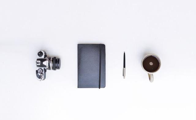 Still life camera notebook, computer communication.