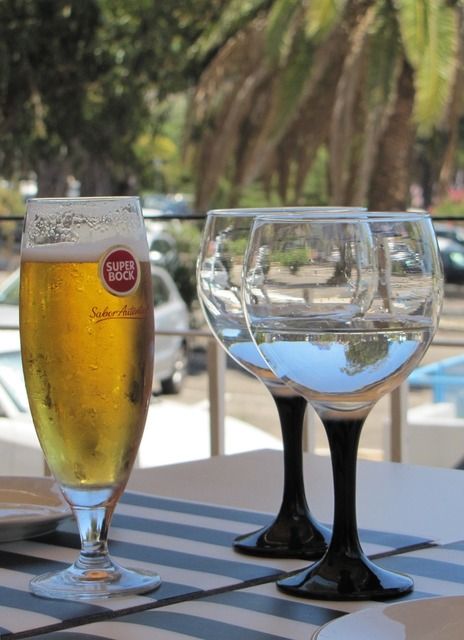 Still life wine glasses beer, food drink.