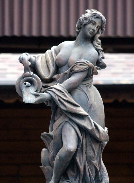 Stone woman park sculpture sculpture.