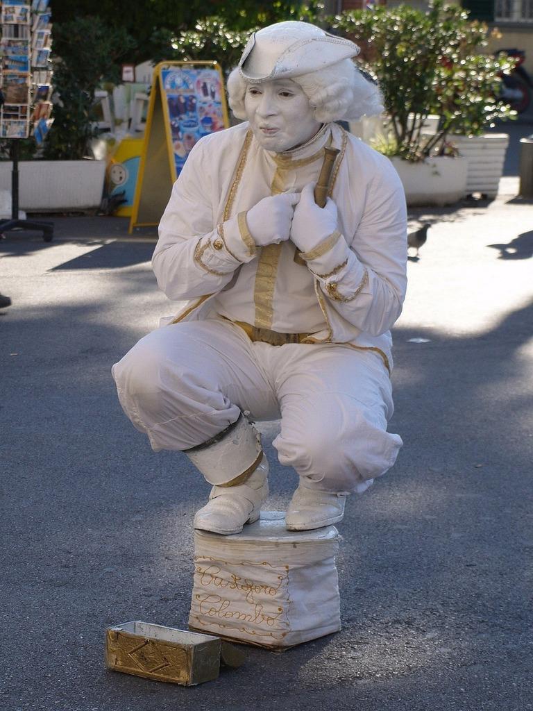 Street artists statue pantomime.