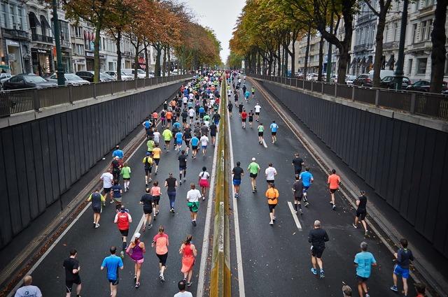 Street marathon running competitors, transportation traffic.
