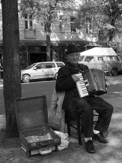 Street musicians accordion player older gentleman.