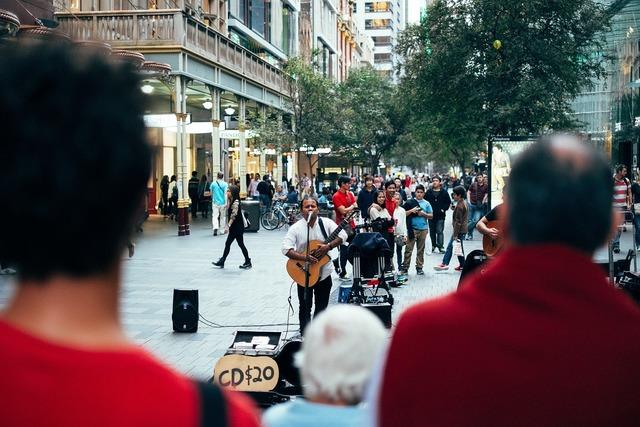 Street performer busker musician, music.