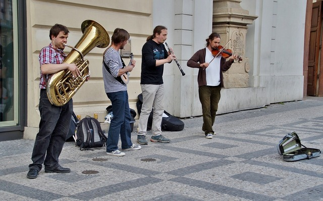 Street performers group musicians, transportation traffic.