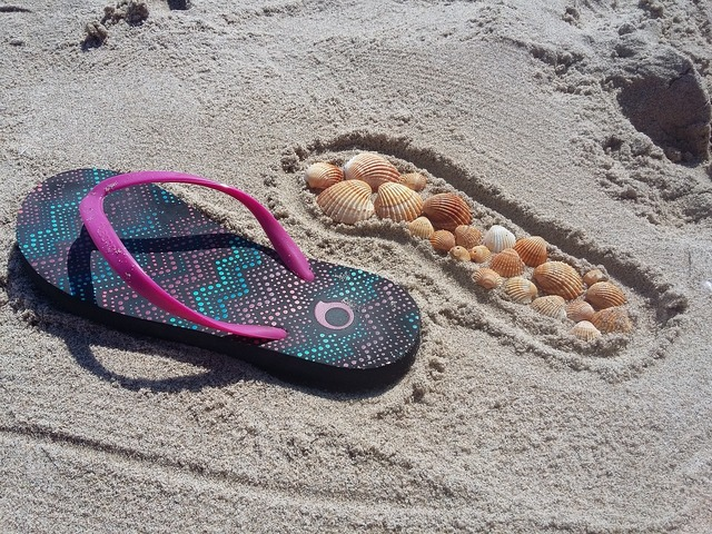 Summer flip flops sand, travel vacation.