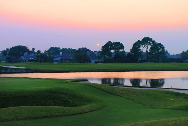 Sunset over the golf course grass golf.