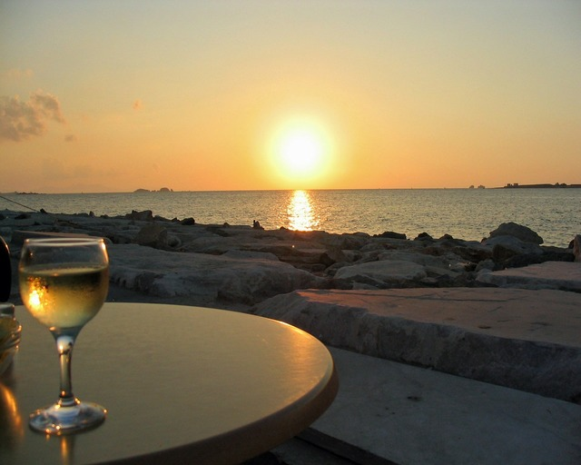 Sunset sea wine glass, travel vacation.