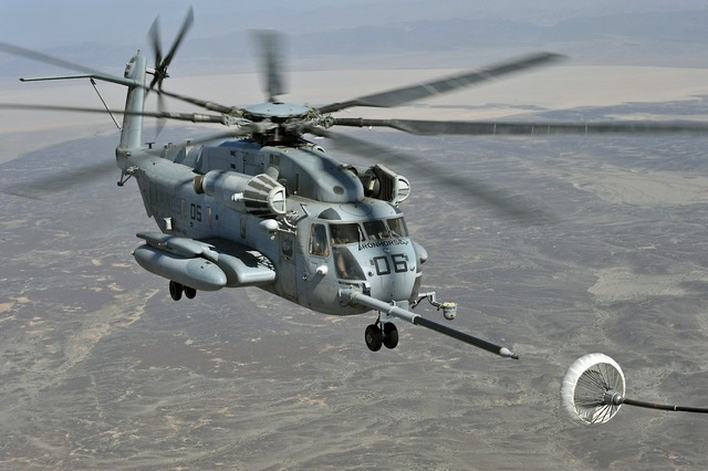 Super stallion helicopter refueling in flight military, transportation traffic.