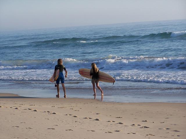Surfer beach run, travel vacation.