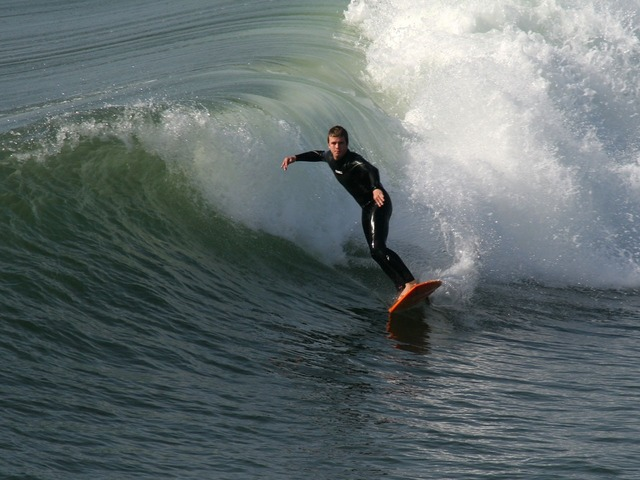Surfer surfing huntington, travel vacation.