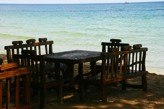 Table and chairs ocean sand, travel vacation.