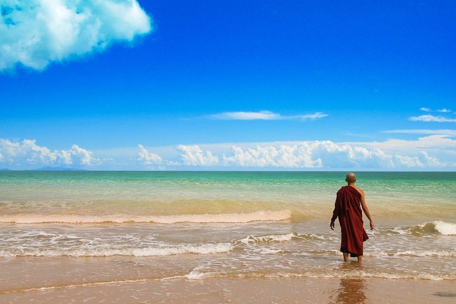 Theravada buddhism monk at beach beach, travel vacation.