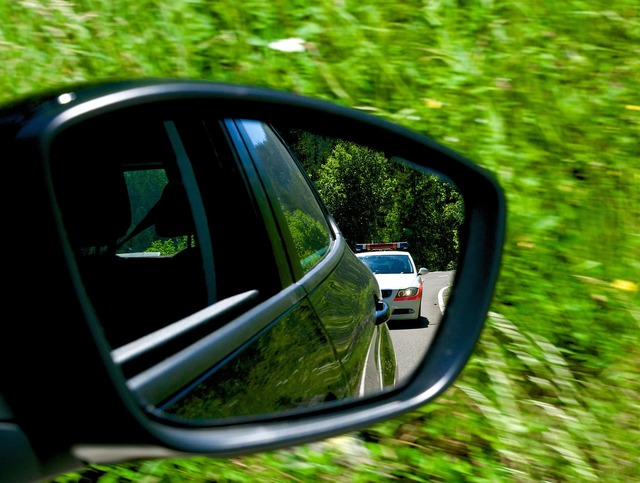 Tracking police rear mirror.