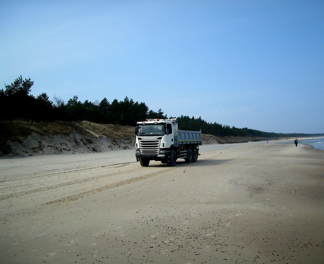 Truck beach sand, transportation traffic.
