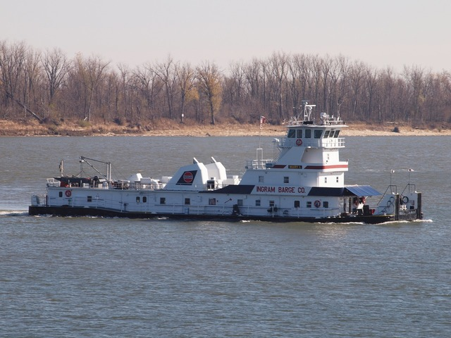 Tugboat river towing, transportation traffic.