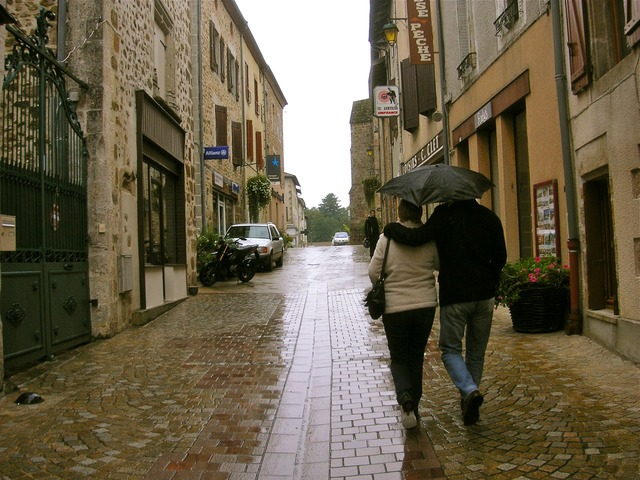 Umbrella couple wet, transportation traffic.