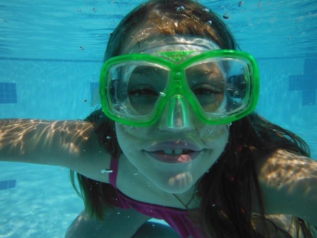 Underwater swimmer with mask summer pool.