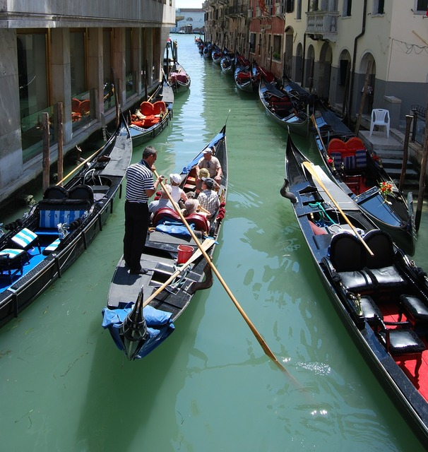 Venice gondola channel, transportation traffic.