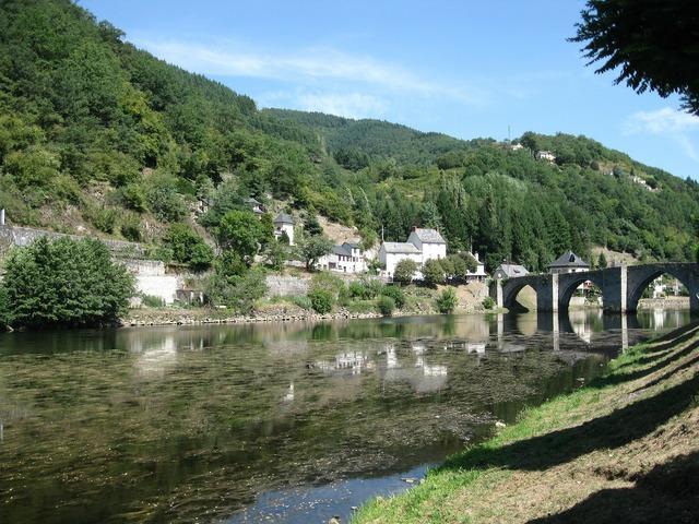 Village mountains river.