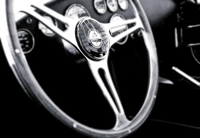 Vintage car steering wheel, transportation traffic.