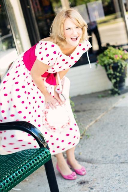 Vintage woman polka dot dress laughing, emotions.