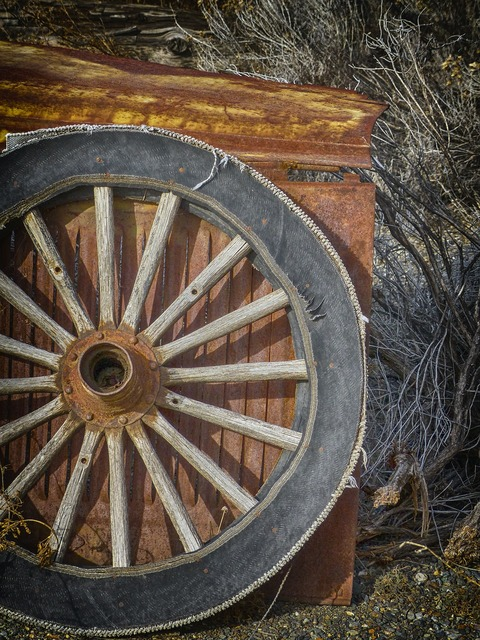 Wagon wheel old wooden, backgrounds textures.