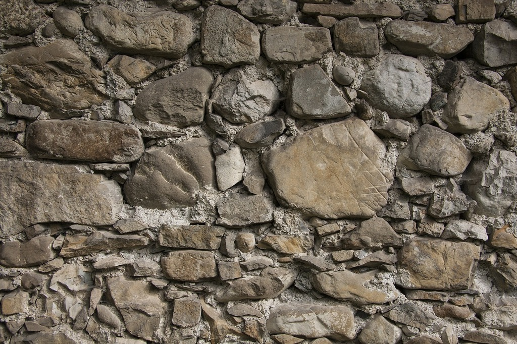 Wall natural stone layered, backgrounds textures.