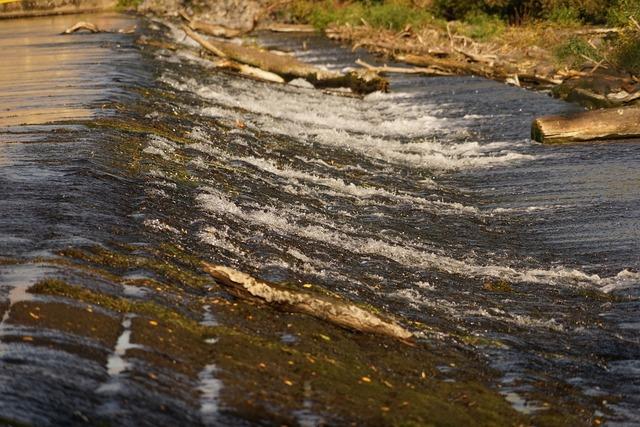 Water running weir river.