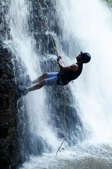 Waterfall rappelling waterfall wet.