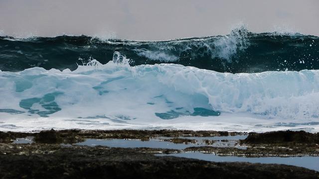 Wave smashing foam, travel vacation.