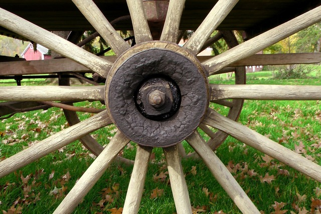 Wheel wooden hand turned.