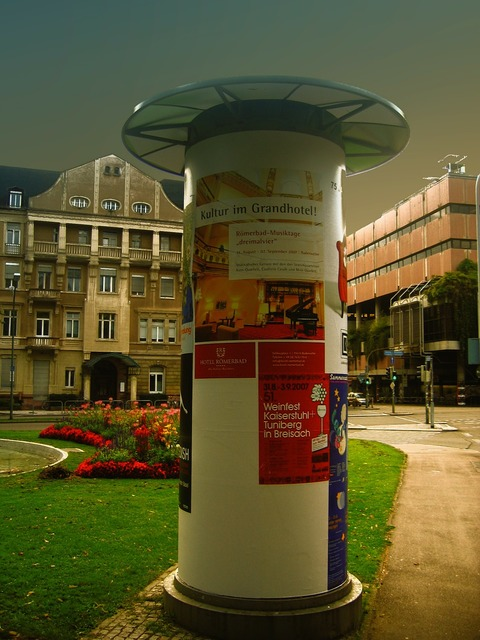 Wih advertising pillar posters, transportation traffic.