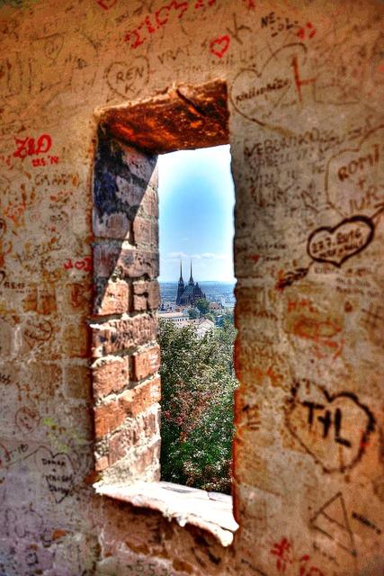 Window brick graffiti, religion.