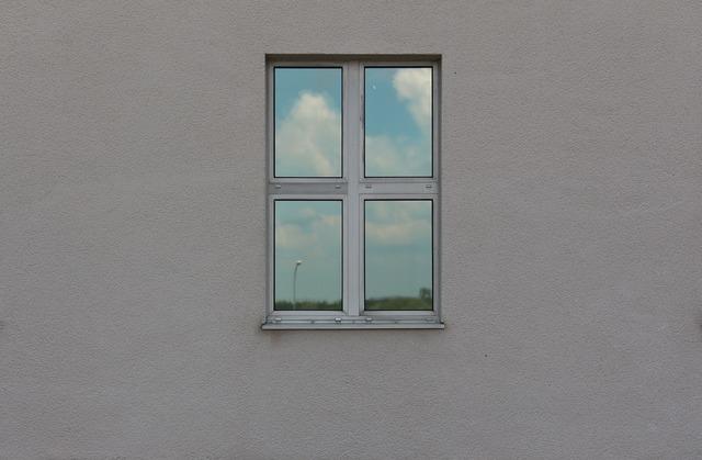 Window mirroring sky.