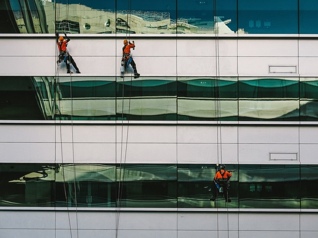 Windows washing workers, architecture buildings.