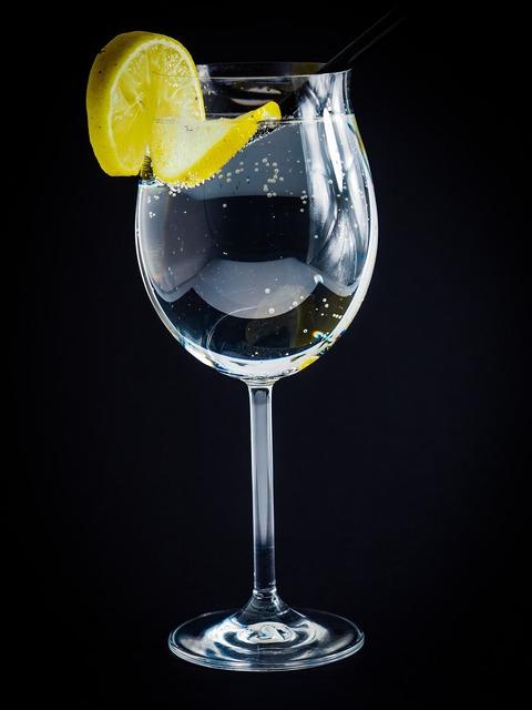 Wine glass lemon water bubbles, food drink.