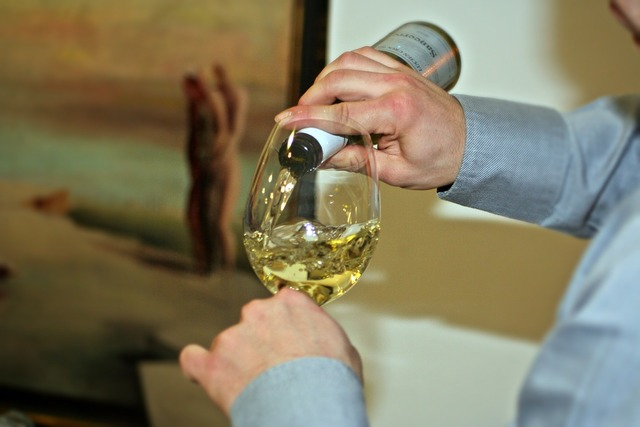 Wine pouring sommelier.