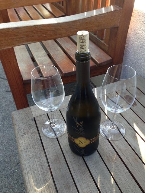 Wine wine glasses wine bottle.
