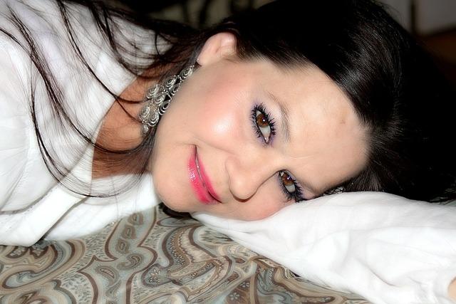 Woman laying down face, beauty fashion.