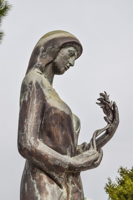 Woman mother sculpture, beauty fashion.