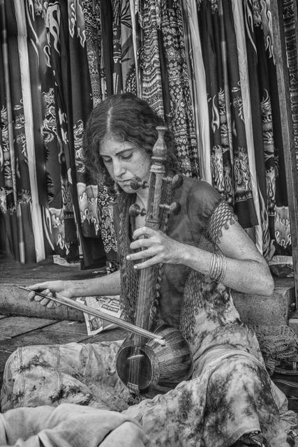 Women siting play, music.