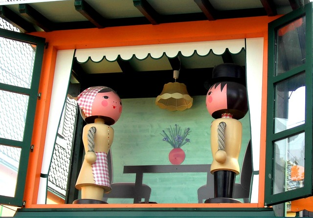 Wooden figures pair turned to two figures.
