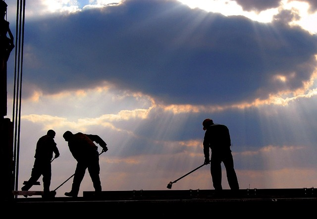Workers brooms mops.