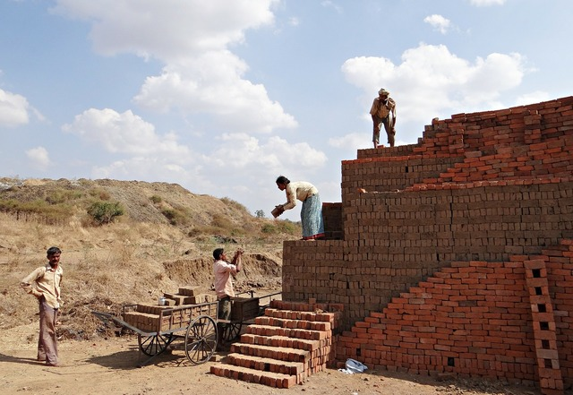 Workers country-side brick-laying, architecture buildings.