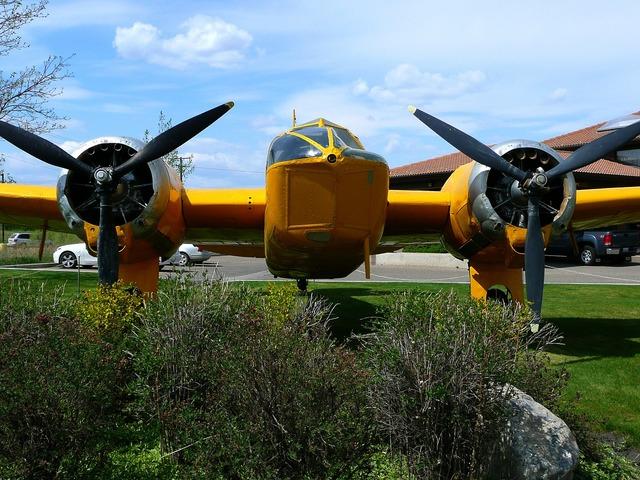 Yellow plane aircraft, transportation traffic.