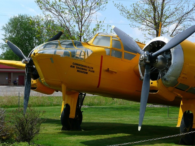 Yellow two engine propeller plane.