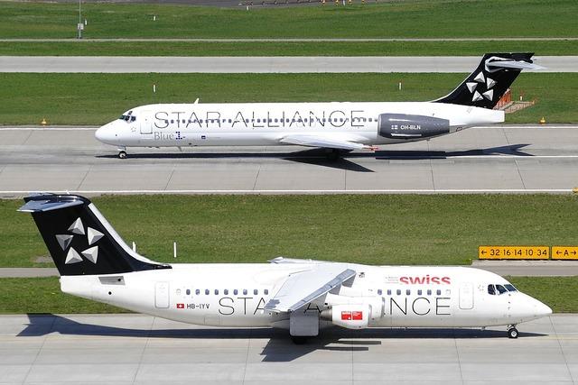 Zurich international airport jets passengers, business finance.